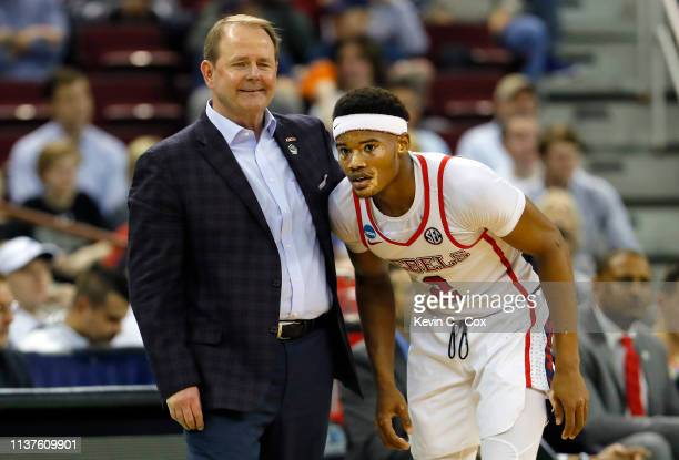 Head coach Kermit Davis of the Mississippi Rebels speaks to Terence Davis in the second half against the Oklahoma Sooners during the first round of...