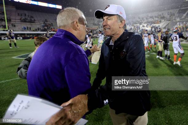 Head coach Kevin Coyle of Atlanta Legends and head coach Steve Spurrier of Orlando Apollos meet on the field following the game on February 09 2019...