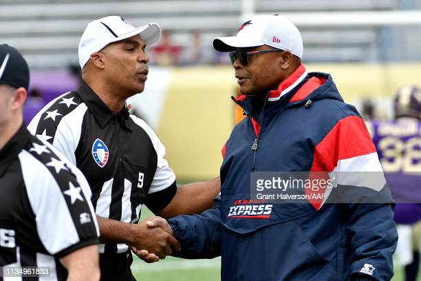 Head coach Kevin Coyle of Atlanta Legends meets with referee Tra Blake prior to the Alliance of American Football game against the Atlanta Legends at...