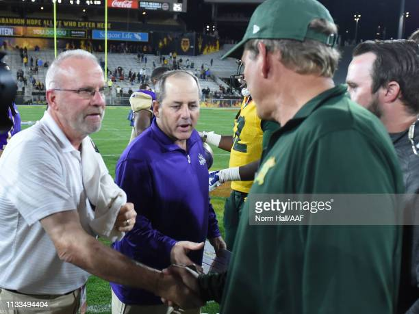 Head coach Kevin Coyle of the Atlanta Legends shakes hands with head coach Rick Neuheisel of the Arizona Hotshots after the Legends defeated the...