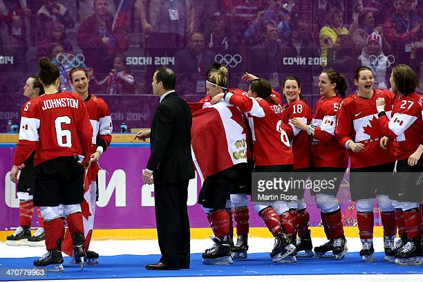 Head coach Kevin Dineen of Canada and players celebrate during the flower ceremony for the Ice Hockey Women's Gold Medal Game on day 13 of the Sochi...