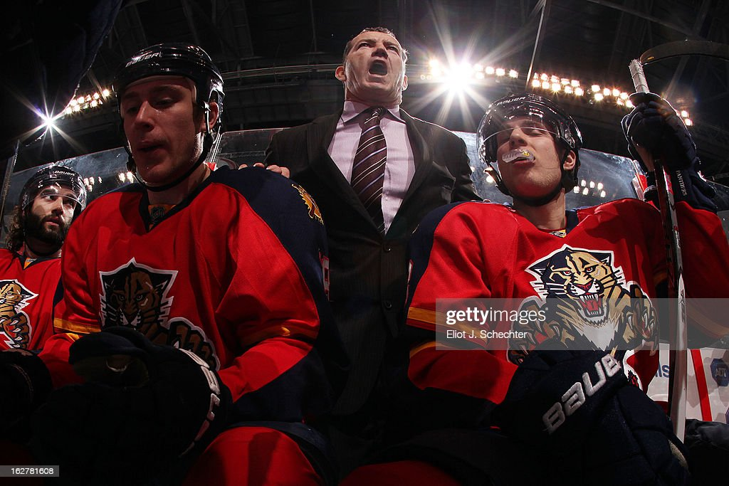 Head Coach Kevin Dineen of the Florida Panthers directs his team from the bench against the Pittsburgh Penguins at the BB&T Center on February 26, 2013 in Sunrise, Florida.