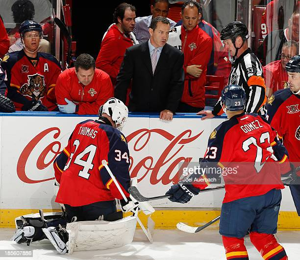 Head coach Kevin Dineen of the Florida Panthers talks to Referee Kevin Pollock in regard to the injury of goaltender Tim Thomas during third period...