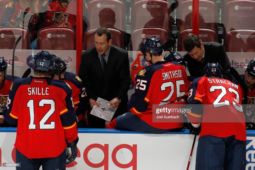 Head coach Kevin Dineen of the Florida Panthers talks to the players during a time out in the third period against the Toronto Maple Leafs at the BB&T Center on February 18, 2013 in Sunrise, Florida. The Maple Leafs defeated the Panthers 3-0.