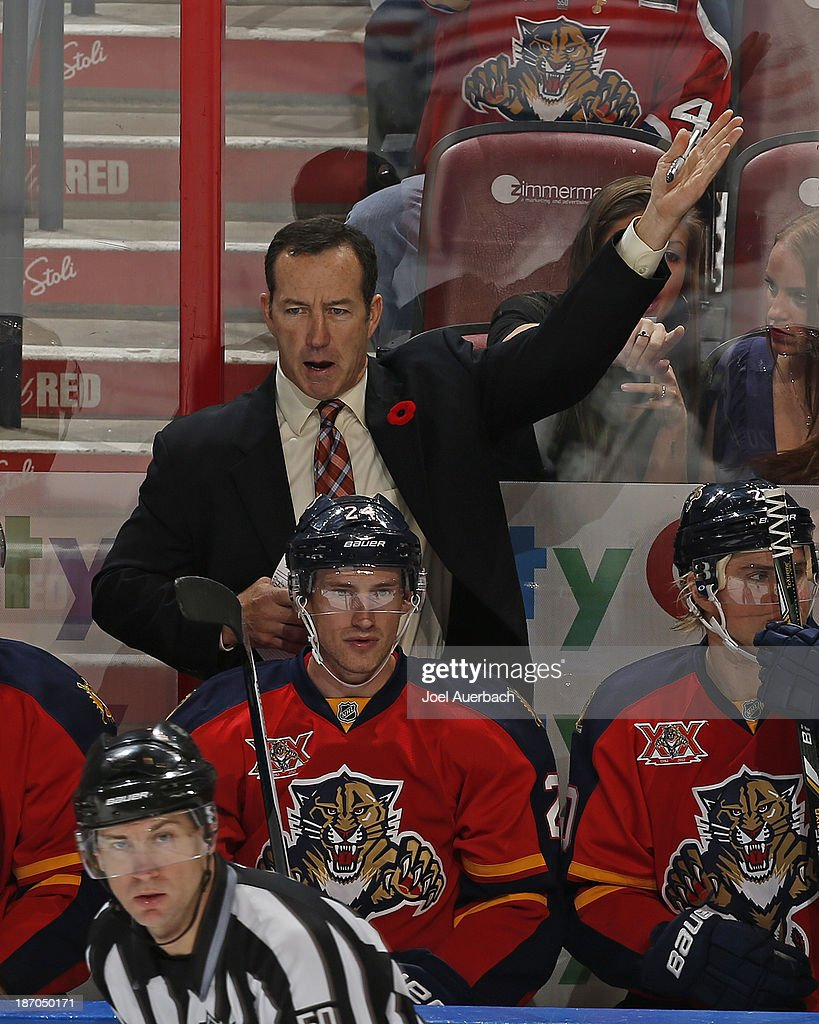 Head coach Kevin Dineen signals goaltender Jacob Markstrom #25 (not pictured) of the Florida Panthers to come off the ice for an extra attacker late in the third period against the Edmonton Oilers at the BB&T Center on November 5, 2013 in Sunrise, Florida. The Oilers defeated the Panthers 4-3 in overtime.