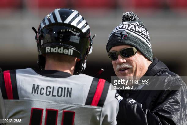 Head Coach Kevin Gilbride of the NY Guardians speaks with Matt McGloin before the XFL game against the DC Defenders at Audi Field on February 15,...