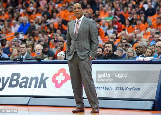Head coach Kevin Keatts of the North Carolina State Wolfpack looks on against the Syracuse Orange during the first half at the Carrier Dome on...