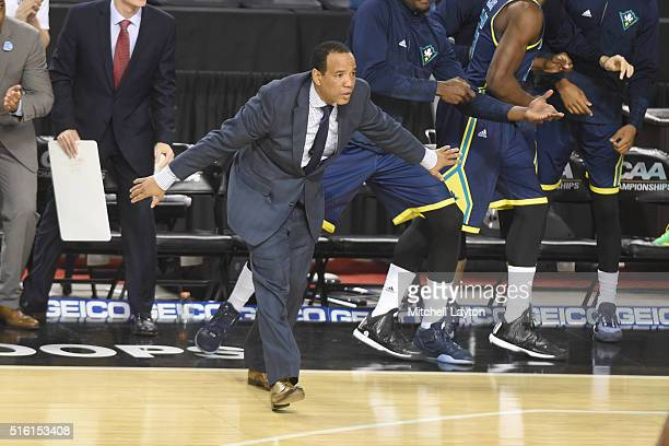 Head coach Kevin Keatts of the North CarolinaWilmington Seahawks reacts to a call during the Colonial Athletic Conference Championship college...