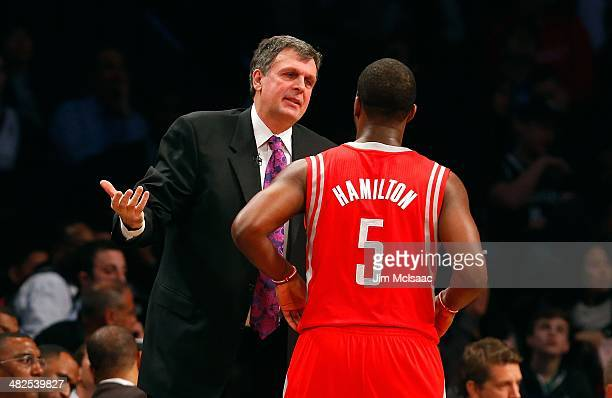 Head coach Kevin McHale of the Houston Rockets ralks with Jordan Hamilton during a game against the Brooklyn Nets at Barclays Center on April 1 2014...