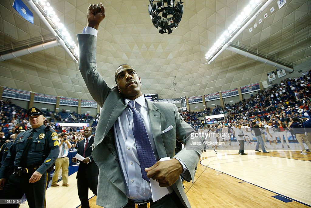 Head coach Kevin Ollie of the Connecticut Huskies celebrates following their last second win against the Florida Gators during the game at Harry A. Gampel Pavilion on December 2, 2013 in Storrs, Connecticut.