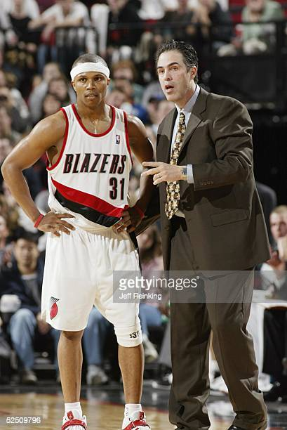 Head coach Kevin Pritchard of the Portland Trail Blazers talks to his teammate Sebastian Telfair during the game against the Chicago Bulls on March 9...