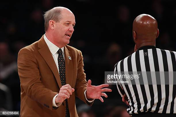Head coach Kevin Stallings of the Pittsburgh Panthers argues with a referee against the Marquette Golden Eagles in the second half of the 2K Classic...