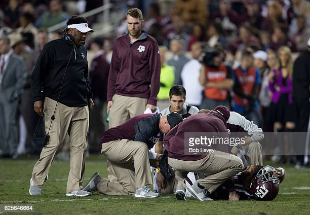 Head coach Kevin Sumlin of the Texas AM Aggies left looks on as Trevor Knight is looked at after suffering an apparent knee injury against the LSU...