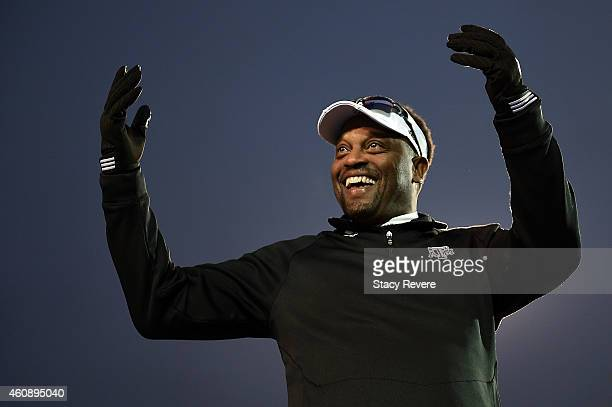 Head coach Kevin Sumlin of the Texas AM Aggies looks to the crowd following a victory over the West Virginia Mountaineers in the 56th annual Autozone...