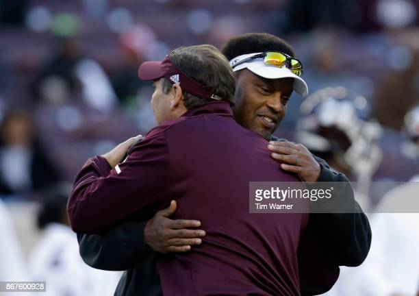 Head coach Kevin Sumlin of the Texas AM Aggies meets with head coach Dan Mullen of the Mississippi State Bulldogs prior to the game at Kyle Field on...