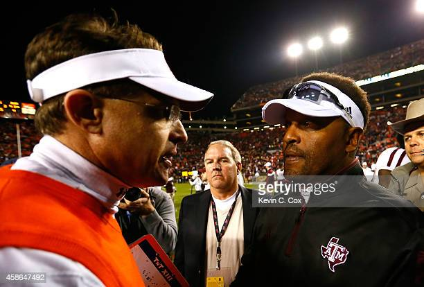 Head coach Kevin Sumlin of the Texas AM Aggies shakes hands with head coach Gus Malzahn of the Auburn Tigers after their 4138 win at Jordan Hare...