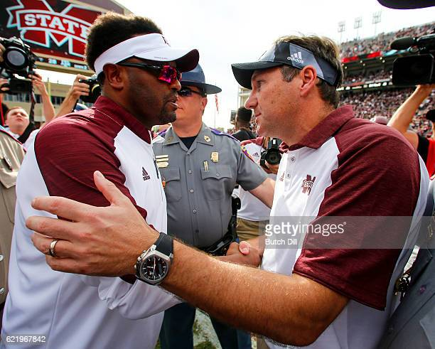 Head coach Kevin Sumlin of the Texas AM Aggies shakes hands with Head coach Dan Mullen of the Mississippi State Bulldogs after the end of an NCAA...