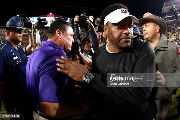 Head coach Kevin Sumlin of the Texas AM Aggies shakes hands with Head coach Ed Orgeron of the LSU Tigers after his team was defeated by LSU 45 21 at...