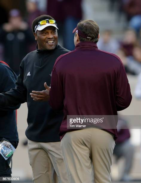 Head coach Kevin Sumlin of the Texas AM Aggies talks with head coach Dan Mullen of the Mississippi State Bulldogs before the game at Kyle Field on...
