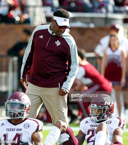 Head coach Kevin Sumlin of the Texas AM Aggies walks around before the start of an NCAA college football game against the Mississippi State Bulldogs...