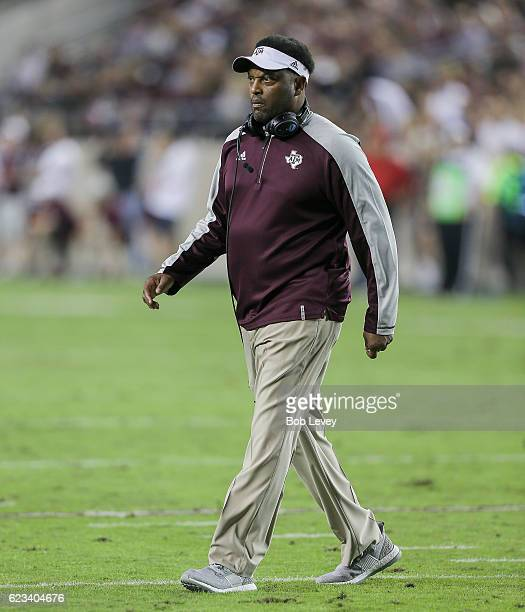 Head coach Kevin Sumlin of the Texas AM Aggies walks onto the field to check on Armani Watts who injured the play against the Mississippi Rebels at...
