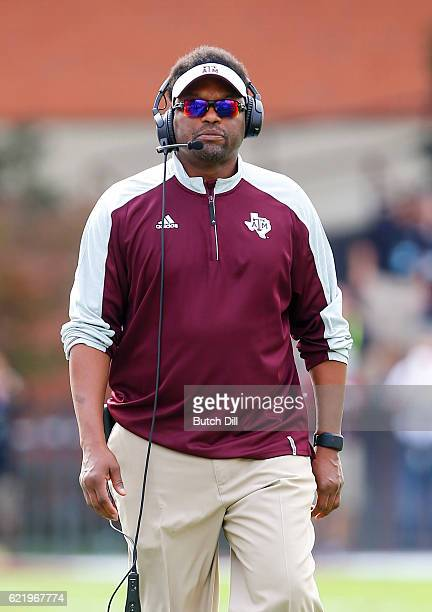Head coach Kevin Sumlin of the Texas AM Aggies walks the sideline during the first half of an NCAA college football game against the Mississippi...