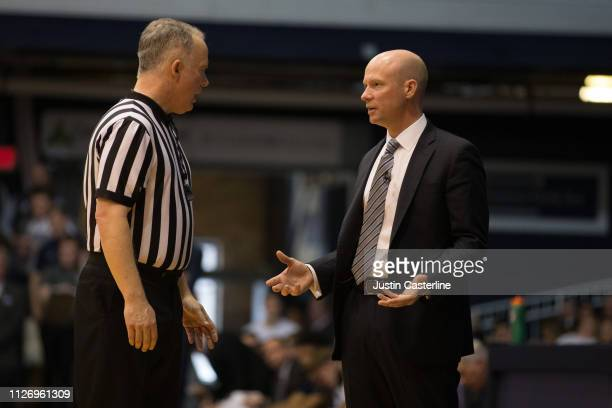 Head coach Kevin Willard of the Seton Hall Pirates talks to an official in the game against the Butler Bulldogs during the second half at Hinkle...