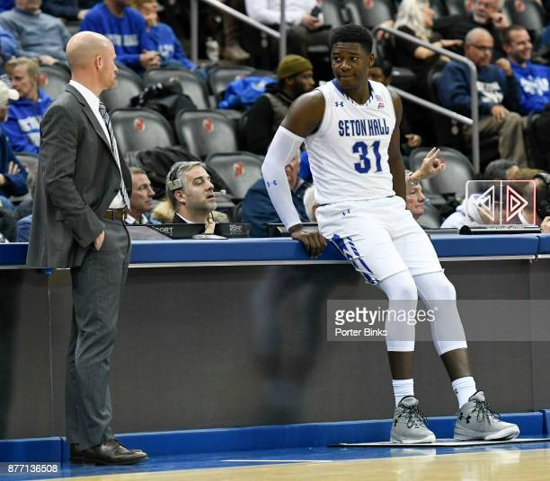 Head coach Kevin Willard of the Seton Hall Pirates with Angel Delgado during a game against the Fairleigh Dickinson Knights at the Prudential Center...