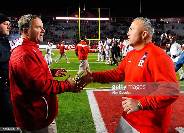 Head coach Kevin Wilson of the Indiana Hoosiers shakes the hand of head coach Kyle Flood of the Rutgers Scarlet Knights after a game at High Point...