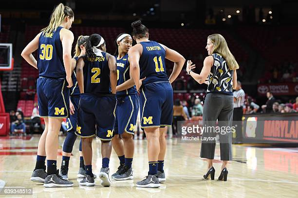 Head coach Kim Barnes Arico of the Michigan Wolverines talks to her players during a women's college basketball game against the Maryland Terrapins...