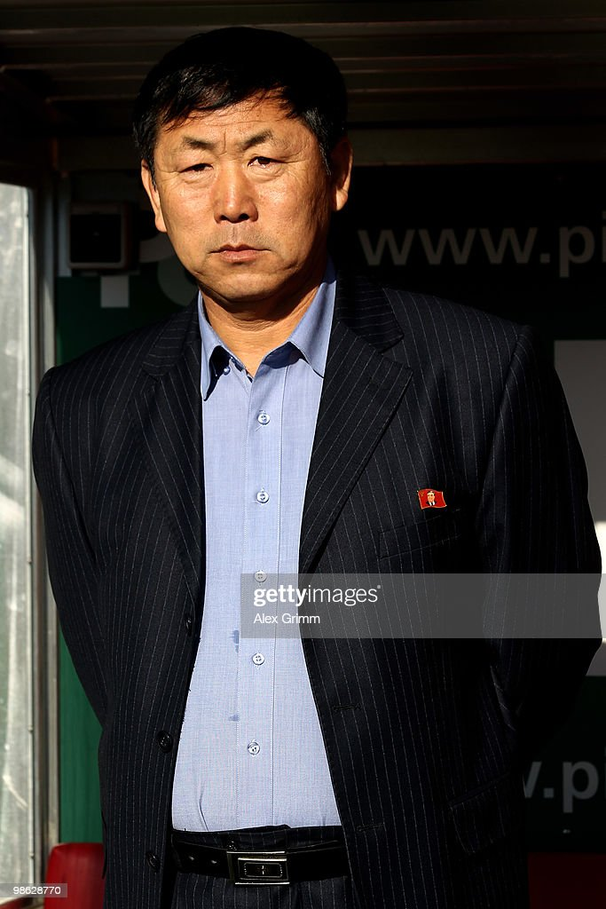 Head coach Kim Jong Hun of North Korea reacts before during the international friendly match between South Africa and North Korea at the Brita arena on April 22, 2010 in Wiesbaden, Germany.