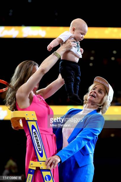 Head coach Kim Mulkey of the Baylor Lady Bears and her daughter Makenzie Marie Robertson celebrate with grandson Kannon Reid Fuller after the 8281...