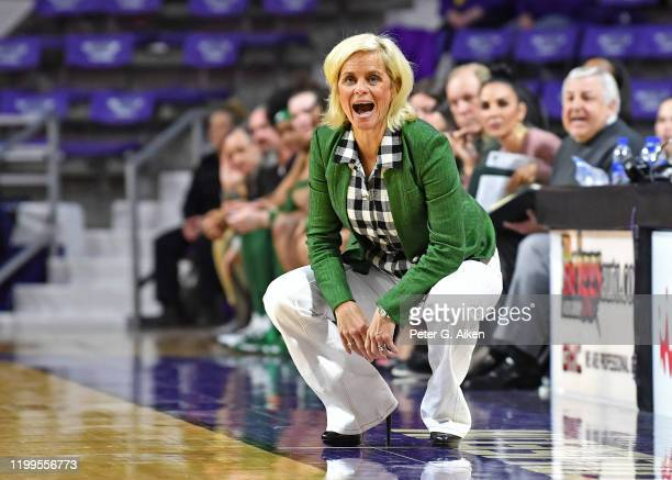 Head coach Kim Mulkey of the Baylor Lady Bears calls out instructions to her players during the third quarter against the Kansas State Wildcats on...
