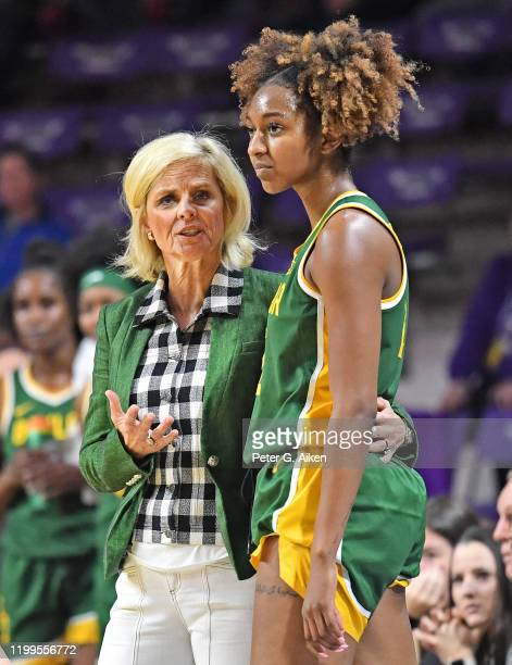 Head coach Kim Mulkey of the Baylor Lady Bears talks with DiDi Richards during the third quarter against the Kansas State Wildcats on February 8 2020...