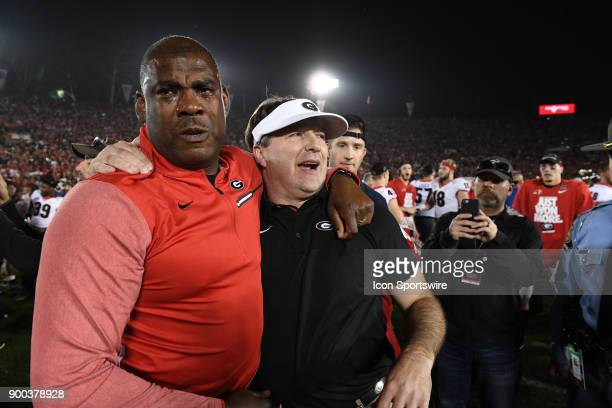 Head Coach Kirby Smart and defensive coordinator Mel Tucker of the Georgia Bulldogs and celebrate after the Bulldogs victory in the College Football...