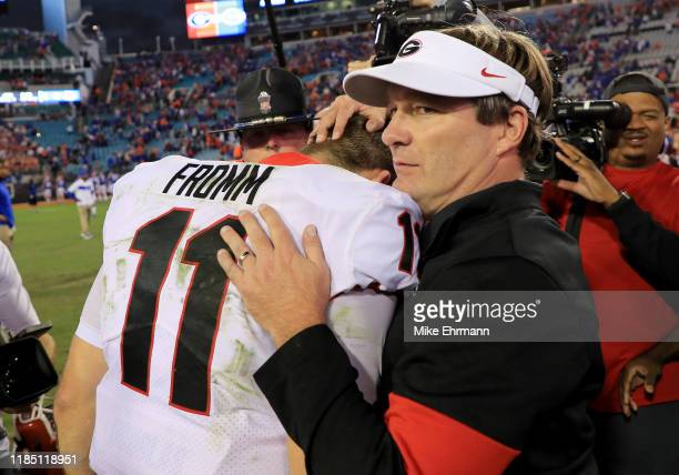 Head coach Kirby Smart and Jake Fromm of the Georgia Bulldogs celebrate after winning a game against the Florida Gators on November 02 2019 in...