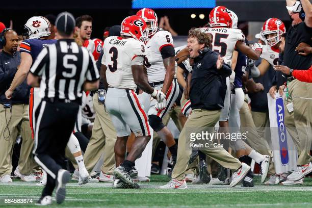 Head coach Kirby Smart of the Georgia Bulldogs celebrates a blocked field goal with Roquan Smith during the second half against the Auburn Tigers in...