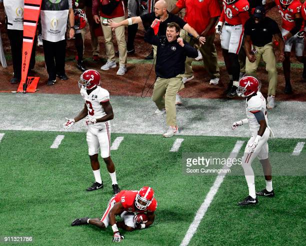 Head Coach Kirby Smart of the Georgia Bulldogs celebrates after a turnover against the Alabama Crimson Tide in the CFP National Championship...