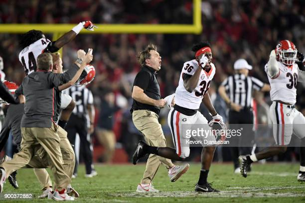 Head Coach Kirby Smart of the Georgia Bulldogs celebrates after the Bulldogs win the 2018 College Football Playoff Semifinal Game against the...