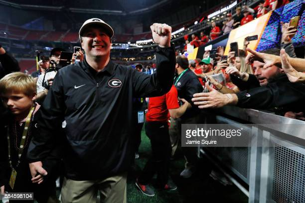 Head coach Kirby Smart of the Georgia Bulldogs celebrates beating Auburn Tigers in the SEC Championship at MercedesBenz Stadium on December 2 2017 in...
