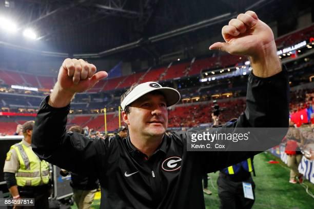 Head coach Kirby Smart of the Georgia Bulldogs celebrates beating the Auburn Tigers in the SEC Championship at MercedesBenz Stadium on December 2...