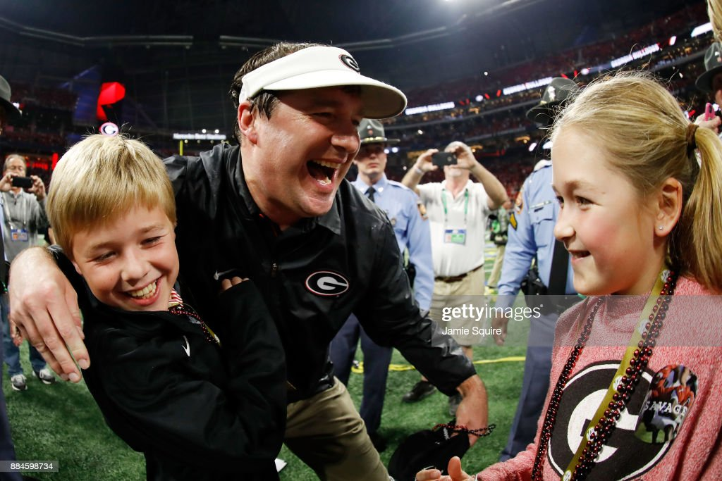 Head coach Kirby Smart of the Georgia Bulldogs celebrates with his family after beating the Auburn Tigers in the SEC Championship at Mercedes-Benz Stadium on December 2, 2017 in Atlanta, Georgia.
