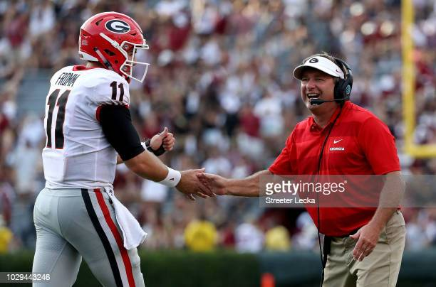 Head coach Kirby Smart of the Georgia Bulldogs celebrates with Jake Fromm of the Georgia Bulldogs during their game against the South Carolina...