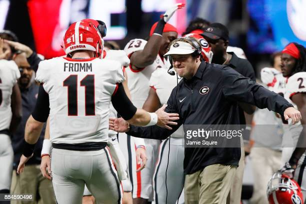 Head coach Kirby Smart of the Georgia Bulldogs celebrates with Jake Fromm after a touchdown during the second half against the Auburn Tigers in the...