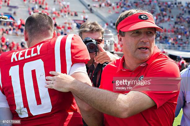 Head Coach Kirby Smart of the Georgia Bulldogs congratulates Chad Kelly of the Mississippi Rebels at VaughtHemingway Stadium on September 24 2016 in...