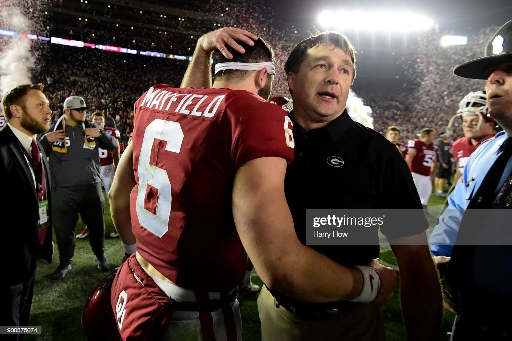 Head Coach Kirby Smart of the Georgia Bulldogs hugs quarterback Baker Mayfield #6 of the Oklahoma Sooners after the Bullsdogs beat the Oklahoma Sooners 54-48 in double overtime in the 2018 College Football Playoff Semifinal Game at the Rose Bowl Game presented by Northwestern Mutual at the Rose Bowl on January 1, 2018 in Pasadena, California.