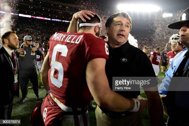 Head Coach Kirby Smart of the Georgia Bulldogs hugs quarterback Baker Mayfield of the Oklahoma Sooners after the Bullsdogs beat the Oklahoma Sooners...