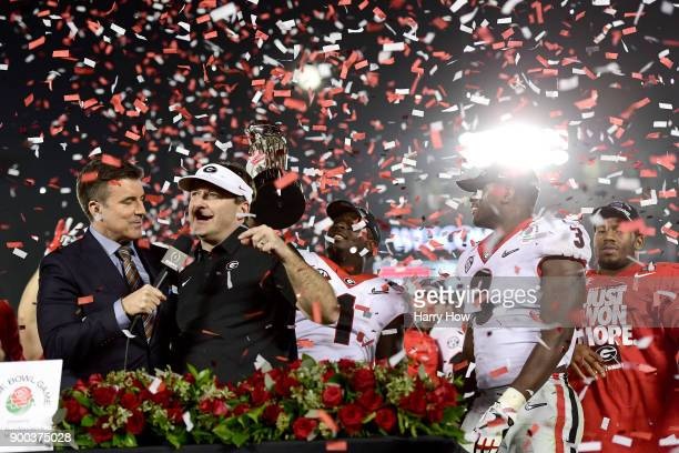 Head Coach Kirby Smart of the Georgia Bulldogs is presented the trophy after the Bulldogs beat the Oklahoma Sooners 5448 in double overtime in the...
