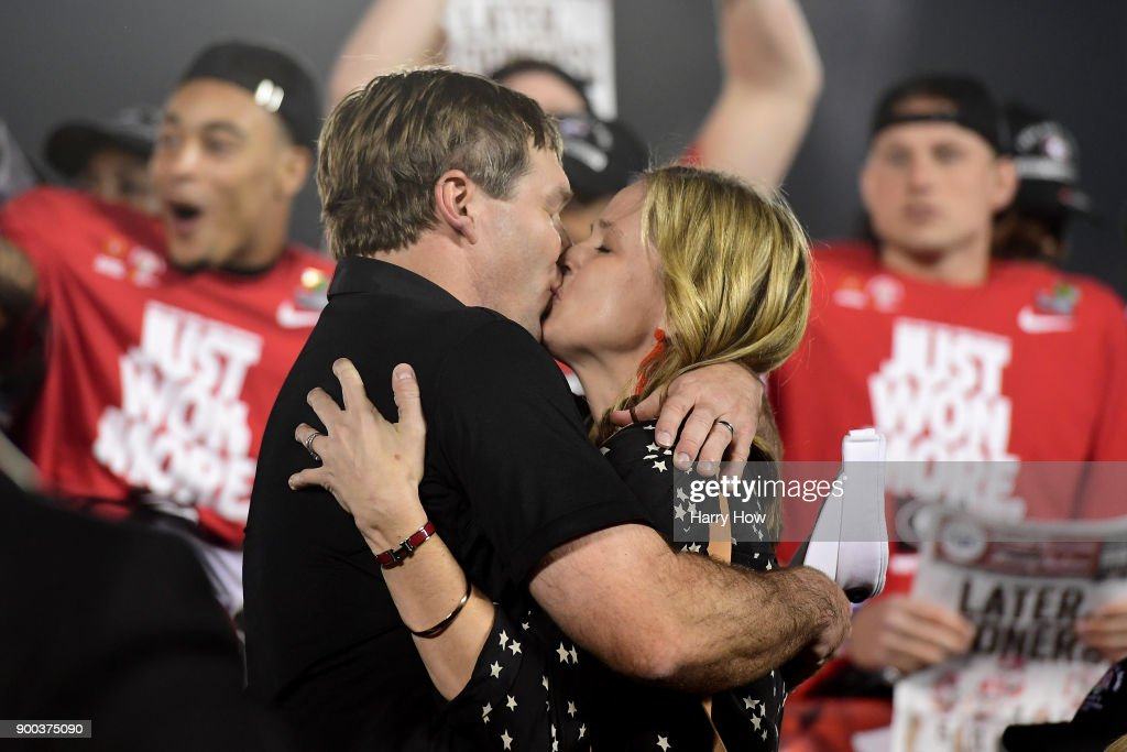 Head Coach Kirby Smart of the Georgia Bulldogs kisses his wife Mary Beth Lycett after the Bulldogs beat the Oklahoma Sooners in the 2018 College Football Playoff Semifinal Game at the Rose Bowl Game presented by Northwestern Mutual at the Rose Bowl on January 1, 2018 in Pasadena, California.