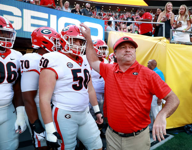 Head coach Kirby Smart of the Georgia Bulldogs leads his team onto the field before their game against the Clemson Tigers in the Duke's Mayo Classic...